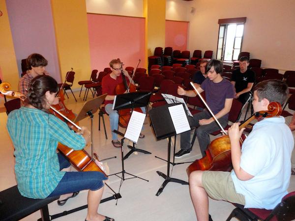 Alex rehearses his work for cello quartet.
