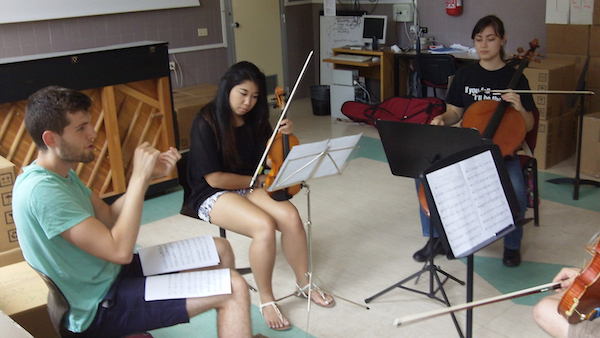 Grant rehearses with Grace, Jenaesha and Sean (not pictured).